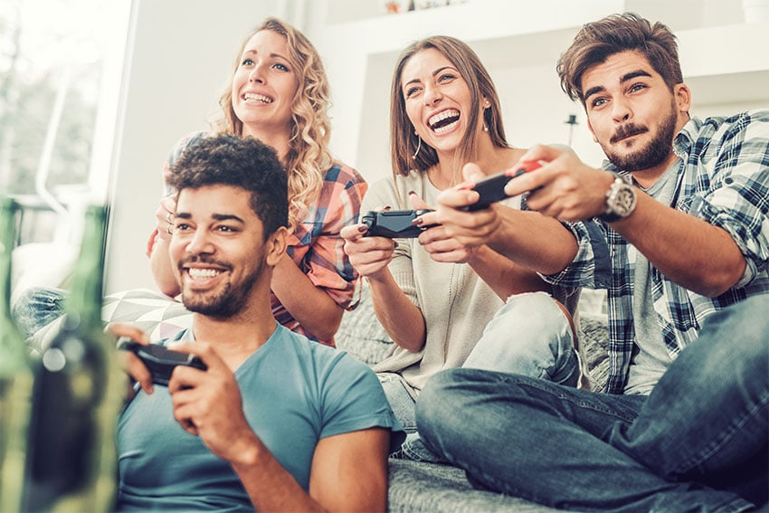 group of young adults playing a video game